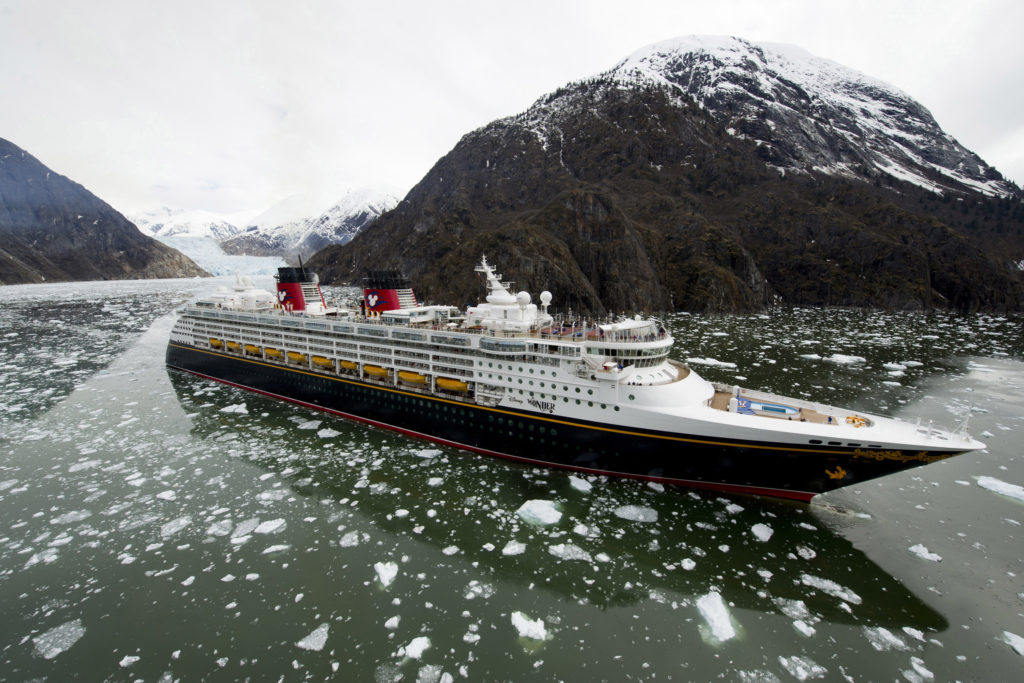 Disney Cruise Line Reveals New Itineraries for Summer 2022  The Disney Wonder cruise ship sails past glaciers in a fjord as part of its Alaska itinerary. These scenic destinations are home to towering waterfalls, mammoth glaciers, rugged mountaintops and wildlife. (Diana Zalucky, photographer)